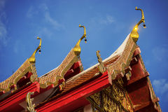 Thai temple roof with blue sky Stock Photos