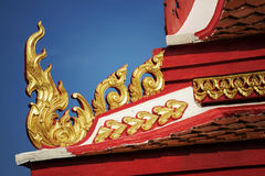 Thai temple roof with blue sky Stock Photo