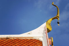 Thai temple roof with blue sky Royalty Free Stock Image