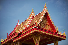 Thai temple roof with blue sky Royalty Free Stock Photos