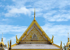 Thai Temple Roof Front side with Thailand painting, Golden art,. Lai Thai, Blue sky background Stock Photography