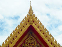 Thai Temple Roof Front side with Thailand painting, Golden art,. Lai Thai, Blue sky background Stock Photo