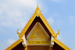 Thai Temple Roof. Gold thai temple's roof and sky Royalty Free Stock Image