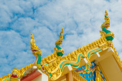 Thai temple roof with king of nagas decoration Royalty Free Stock Photos