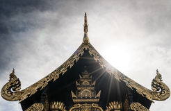 Thai temple roof with sun beam and cloud Royalty Free Stock Photo