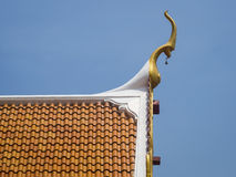 Thai temple Roof Traditional style with blue sky Royalty Free Stock Photo