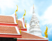 Thai temple roof and white pagoda with blue sky Royalty Free Stock Photography