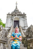 Thai temple sculpture. Thai blue  temple sculpture with white sky Royalty Free Stock Photography