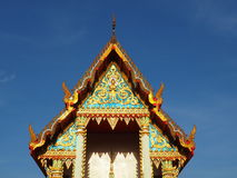 Thai temple soaring into blue sky Royalty Free Stock Images