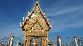 Thai temple soaring into blue sky stock footage