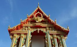 Thai temple soars into blue sky Royalty Free Stock Image