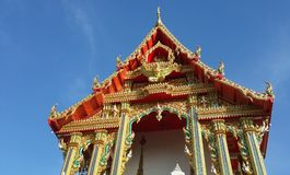 Thai temple soars into blue sky Royalty Free Stock Images