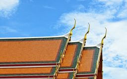 Thai temple style roof tiles Stock Image