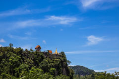 Thai temple on top of mountain cliff Stock Photos