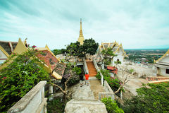 Thai temple on the top of mountain with nice blue sky Stock Photos