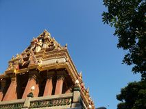 thai temple under blue sky Stock Photos
