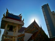 Thai temple under blue sky with sunrise on top of building Royalty Free Stock Image