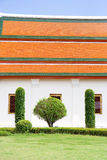 Thai temple. Temple wall with green tree Royalty Free Stock Photos