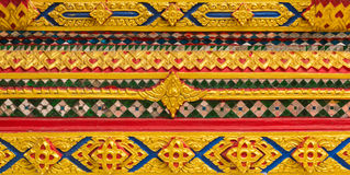 Thai Temple, Wall Thai and Thai Pattern Design on wall. Traditional Ornament Paint on Temple wall Stock Photo