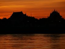 Thai temple `Wat Thai` evening waterfront river side Mekong River Stock Image