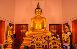 Thai temple. Wat Mongkol Nimit Temple Phuket, Thailand. Golden buddha interior. Thai temple. Wat Mongkol Nimit Temple Phuket, Thailand. Golden buddha interior Stock Photo