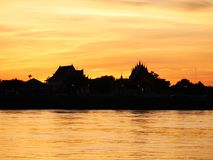Thai temple `Wat Thai` evening waterfront river side Mekong River Stock Photo