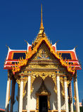 Thai temple Wat Thepnimit soars into blue sky Royalty Free Stock Image