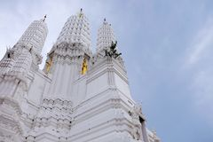 Thai temples and beautiful white pagoda are beautiful stucco designs. The ancient Buddha image. Wat Phra Mahathat Phetchaburi, Thailand royalty free stock images