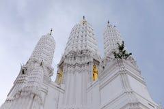 Thai temples and beautiful white pagoda are beautiful stucco designs. The ancient Buddha image. Wat Phra Mahathat Phetchaburi, Thailand stock image