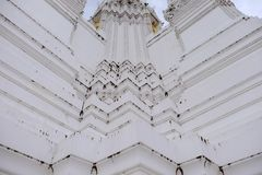 Thai temples and beautiful white pagoda are beautiful stucco designs. The ancient Buddha image. Wat Phra Mahathat Phetchaburi, Thailand royalty free stock image