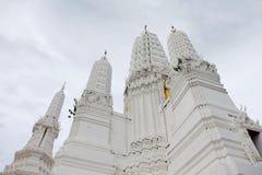Thai temples and beautiful white pagoda are beautiful stucco designs. The ancient Buddha image. Wat Phra Mahathat Phetchaburi, Thailand stock photos