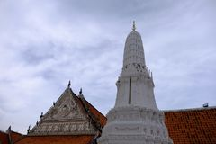 Thai temples and beautiful white pagoda are beautiful stucco designs. The ancient Buddha image. Wat Phra Mahathat Phetchaburi, Thailand stock images