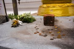 In Thai temples, coins were placed on the floor. Is the belief of making merit in the mind royalty free stock photo
