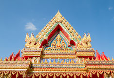 Thai temples roof on blue sky background Stock Photo