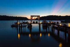 Thai terrace lounges with pergola at sunset on wooden pier in Ko Stock Image