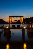 Thai terrace lounges with pergola at sunset on wooden pier in Ko Royalty Free Stock Image