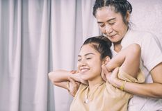 Thai Therapist is stretching woman shoulder and neck. Thai Therapist is stretching a women shoulder and neck Stock Images
