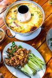 Thai Thom Yum Goong soup. Two of Thailand's most famous dishes Thom Yum Goong soup and 'larb moo' deep fried spicy minced pork royalty free stock photos