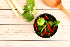 Thai Tom Yam soup herbs and spices. Thai Tom Yam soup herbs and spices, consisting of lemongrass, Kaffir Lime leaves, Galangal, Lemon and Red Chilli on an old Royalty Free Stock Image