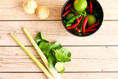 Thai Tom Yam soup herbs and spices. Thai Tom Yam soup herbs and spices, consisting of lemongrass, Kaffir Lime leaves, Galangal, Lemon and Red Chilli on an old Stock Photos