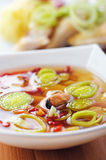 Thai Tom Yum soup with seafood Stock Photo