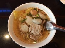Thai tomyum clear soup noodles. With fish ball and pork  bean sprouts Royalty Free Stock Image