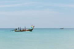 Thai tourist boat with tourists on calm blue sea Royalty Free Stock Image