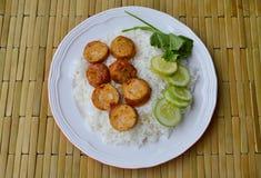 Thai tradition pork sausage slice on rice Royalty Free Stock Image
