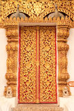 Thai tradition style Buddhist church door. Wat Phra Sing, Chiang Rai province, Thailand royalty free stock photo