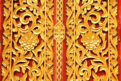 Thai tradition style Buddhist church door Royalty Free Stock Photo