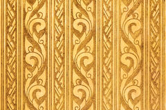 Thai Traditional Carving in Contemporary style on. Gold Plate Background, Horizontal Pattern Royalty Free Stock Photo