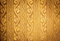 Thai Traditional Carving in Contemporary style. On Gold Plate Background, Horizontal Pattern, Vignette Royalty Free Stock Photo