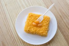 Thai traditional cusine dessert from yolk Cake foi thong. Thai traditional cusine dessert from yolk ,sweet coconut milk and brown shugar call `Cake foi thong` stock photos