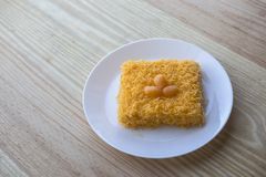 Thai traditional cusine dessert from yolk Cake foi thong. Thai traditional cusine dessert from yolk ,sweet coconut milk and brown shugar call `Cake foi thong` royalty free stock image